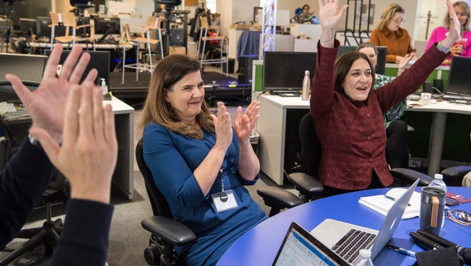 "Nicole Carroll, editor in chief of USA TODAY, and Maribel Perez Wadsworth, president of the USA TODAY NETWORK and publisher of USA TODAY, celebrate as The Arizona Republic receives the Pulitzer Prize for Explanatory Reporting for its project ""The Wall."""