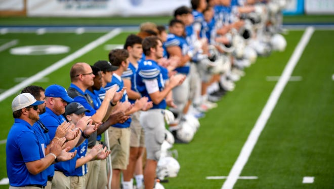 Jackson Christian players line up on the 14 yard line to remember Ryder Lewis, a middle school football player who died this summer, in a TSSAA football game between Jackson Christian and Macon Road Baptist at Jackson Christian School in Jackson, Tenn., on Friday, Sept. 7, 2018.