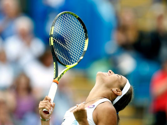 Puerto Rico's Monica Puig celebrates winning against Denmark's Caroline Wozniacki during day three of the 2016 Eastbourne  International tennis tournament at at Devonshire Park, Eastbourne, England, Wednesday, June 22, 2016. (Steve Paston/PA via AP)     UNITED KINGDOM OUT      -     NO SALES      -     NO ARCHIVES