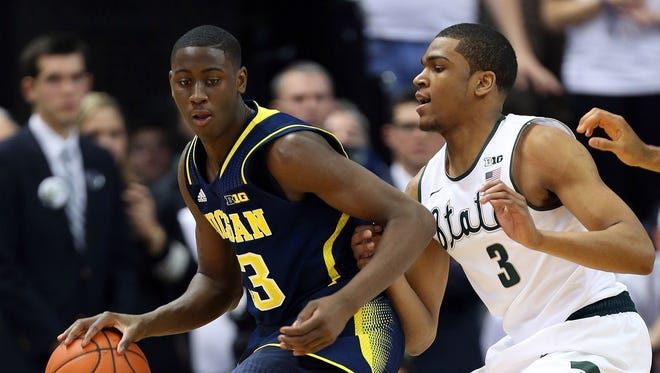Michigan Wolverines guard Caris LeVert (23) posts up against Michigan State Spartans guard Alvin Ellis III (3) during the 2nd half of a game at Jack Breslin Student Events Center. Michigan won, 80-75.