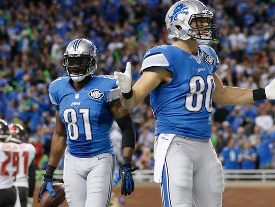 Joe Fauria celebrates a touchdown against the Buccaneers at Ford Field in 2014.