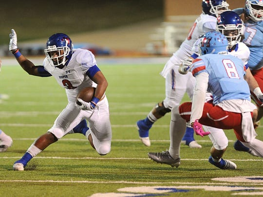 Cooper running back Tyrees Whitfield makes a cut while trying to evade the Lubbock Monterey defense during their District 4-5A opener Friday, Oct. 13, 2017 at Lowrey Field in Lubbock. Monterey won the game 51-44.