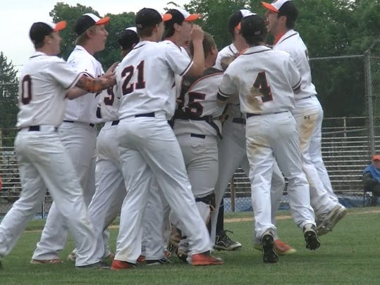 Upper Dauphin players celebrate after their 4-0 upset over Lancaster Catholic in the District 3 Class AA quarterfinals on Thursday.