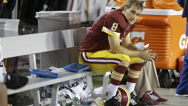 Washington Redskins quarterback and former MSU star Kirk Cousins sits on the bench after his third interception during a late September game last season against the New York Giants. Cousins experienced some rough times in his third season which led to a few sleepless nights.