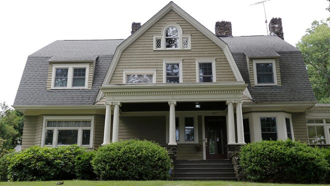 """In this June 25, 2015, file photo, the home of Derek and Maria Broaddus in Westfield, N.J. is viewed. The couple wants to demolish the house after they claim they were stalked by an anonymous creepy-letter writer known as """"The Watcher"""" has filed a lawsuit against their town."""