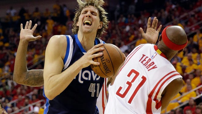 Dallas Mavericks' Dirk Nowitzki (41) goes to the basket against Houston Rockets' Jason Terry (31) during the first half of Game 5 in the first round of the NBA basketball playoffs Tuesday, April 28, 2015, in Houston. (AP Photo/David J. Phillip)