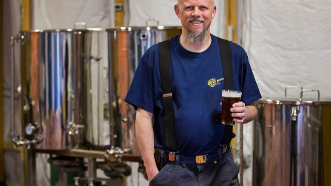 Blue Earl Brewing Company founder Ron Price poses for a portrait at the brewery in Smyrna on Thursday afternoon.
