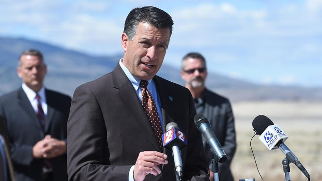 Governor Brian Sandoval speaks in 2015 at an event at Washoe State Park.