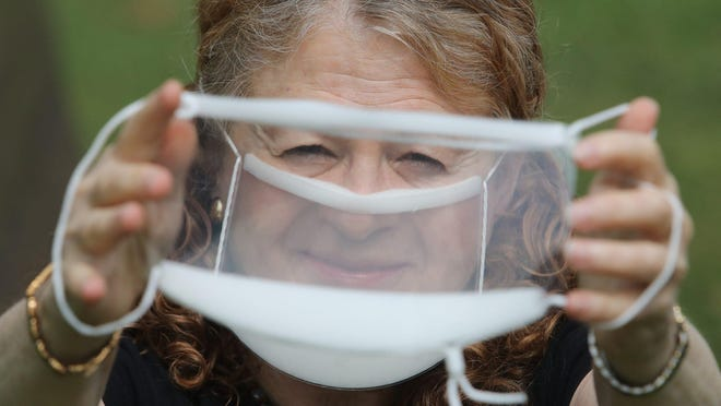 Arlene Romoff of Hackensack holds up one clear mask as she also wears one that helps her and others with hearing impairments read lips of those with whom she communicates especially doctors and other medical providers.