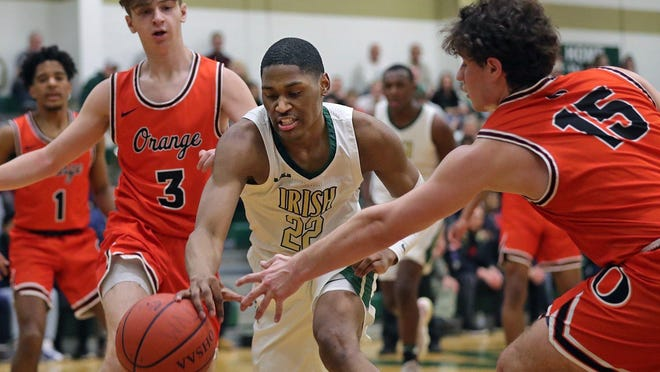 St. Vincent-St. Mary guard Malaki Branham, center, scrambles for a loose ball between Orange forward Tyler Hoffman and Orange guard Harrison Pyner during the first half of a Division II sectional final at St. Vincent-St. Mary High School, Friday, Feb. 28, 2020, in Akron, Ohio.