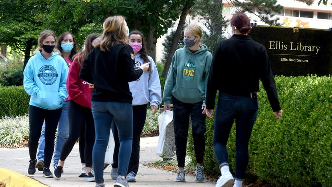 Student tour guides answer questions from high school students and parents touring the University of MIssouri campus on Monday. MU is seeing fewer cases of COVID-19 in recent days after campus leaders stiffened requirements for masks indoors and outdoors.