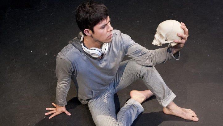 "Adam Rodriguez rehearses a scene from ""Hamlet."" The"