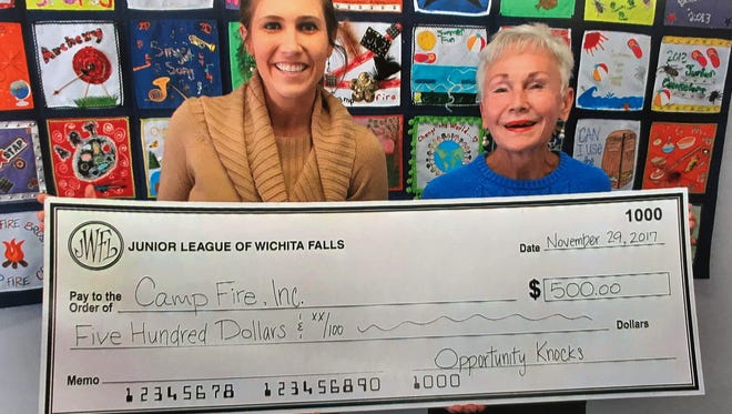 Junior League of Wichita Falls representative Shelly Mills, left, presents Camp Fire Executive Director Bettye Ricks with a check to support Camp Fire programs.