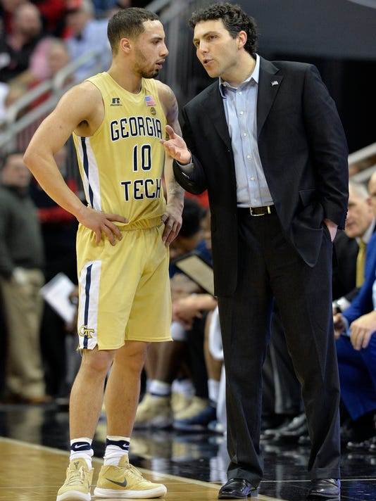 Georgia Tech coach Josh Pastner, right, talks with guard Jose Alvarado during the first half of an NCAA college basketball game against Louisville, Thursday, Feb. 8, 2018, in Louisville, Ky. (AP Photo/Timothy D. Easley)
