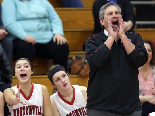 Hortonville coach Jeff Chew motivates his players during their girls' basketball game Jan. 26 in Hortonville.