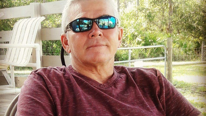 """Jackie """"Kevin"""" Perry of White City was diagnosed with a rare form of brain cancer one year ago. He is one of 11 people identified with similar brain cancers in or near a single Fort Pierce zip code."""