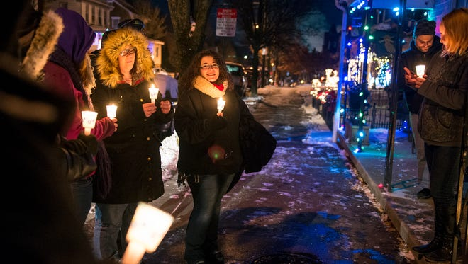 Haley Dircks of North York, center, shares a fond memory during a vigil for Samantha Stein Saturday, Dec. 30, 2017, in Spring Grove. Stein, 24, was fatally stabbed Dec. 16. A neighbor, 59-year-old Raymond William Heck, has been charged in her death.