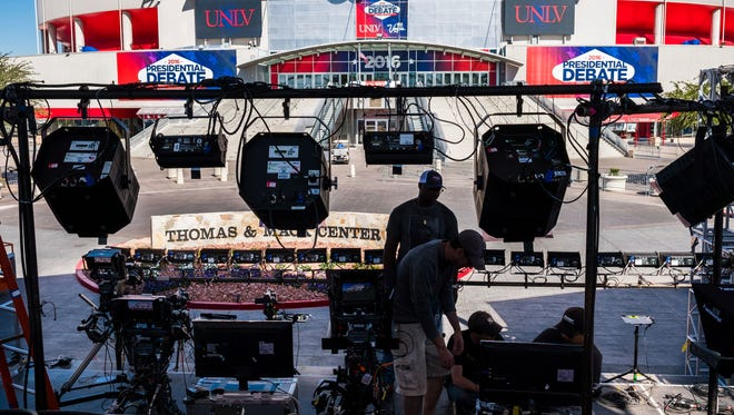 Television crews set up outside of the presidential debate site Monday Oct. 17, 2016 at the University of Nevada, Las Vegas in Las Vegas as preparation continue for the final debate between Democratic presidential nominee Hillary Clinton and Republican presidential nominee Donald Trump.
