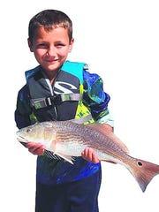 Avid angler Levi Vittur, 7, with redfish