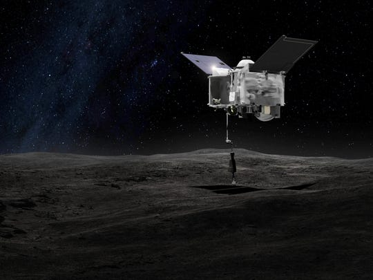 This artist's rendering shows what it may look like when the Osiris-Rex spacecraft contacts the asteroid Bennu.