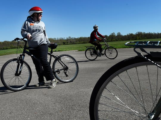 Cate Pham watches cycling instructor Robert Johnson