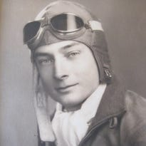 """Frederick """"Fritz"""" Payne's flight logs, pilot wings and medals, including the Navy Cross (far left)."""