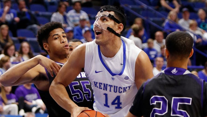 Kentucky's Tai Wynyard (14) splits the defense of Asbury's Jordan Houston (55) and Deion Cochran (25) during the second half of an NCAA college basketball exhibition game, Sunday, Nov. 6, 2016, in Lexington, Ky. Kentucky won 156-63.