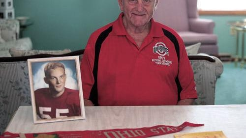 Ed Breehl is pictured in his 2015 photo with some of his memorabilia from the 1958 Rose Bowl Game when Ohio State beat Oregon 10-7. The New Philadelphia resident played center and middle linebacker for the Woody Hayes-coached national champions.