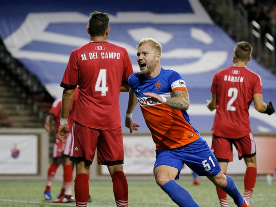 FC Cincinnati defender Sem de Wit (51) celebrates after scoring his team's third goal of the game in the second half of the USL soccer match between FC Cincinnati and the Ottawa Fury at Nippert Stadium in Cincinnati on Wednesday, Aug. 23, 2017. FC Cincinnati secured a 3-1 win over Ottawa before more than 20,000 fans.