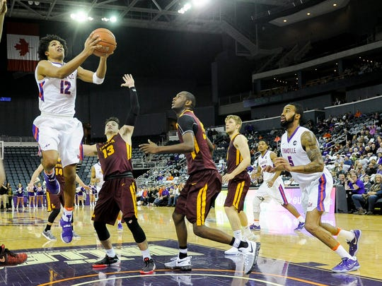 Evansville Aces guard Dru Smith (12) shoots past Loyola Ramblers guard Clayton Custer (13) during their game at the Ford Center in Evansville, Wednesday, Feb. 8, 2017. Evansville beat Loyola 60-58.