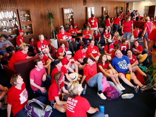 Supporters listen to Senate hearings in the lobby during Day 4 of the #RedForEd walkout at the Arizona Capitol in Phoenix on May 1, 2018.