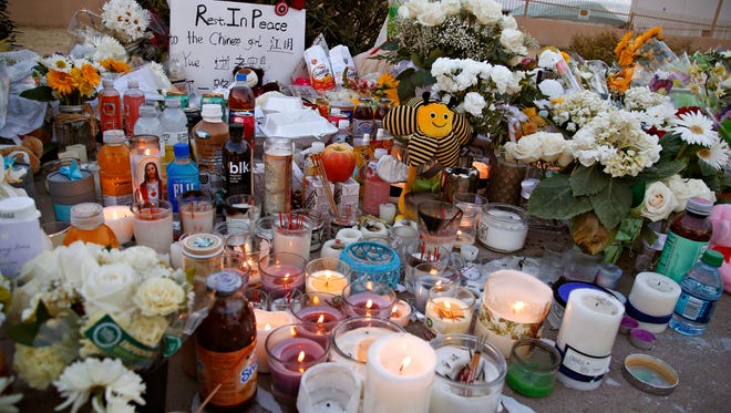 A roadside memorial to Chinese student Yue Jiang, who was killed in a road rage incident in Tempe near the corner of Broadway and McClintock, seen on January 19, 2016.