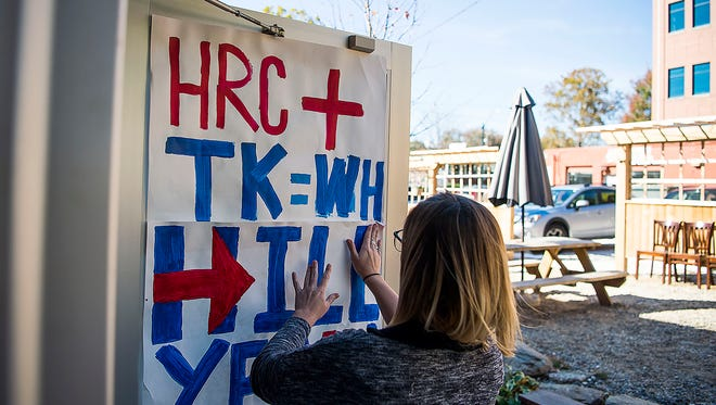 Twin Leaf Brewery on the South Slope gets decorated with Hillary Clinton campaign posters as her team prepares for the arrival of her daughter Chelsea Clinton Saturday afternoon.