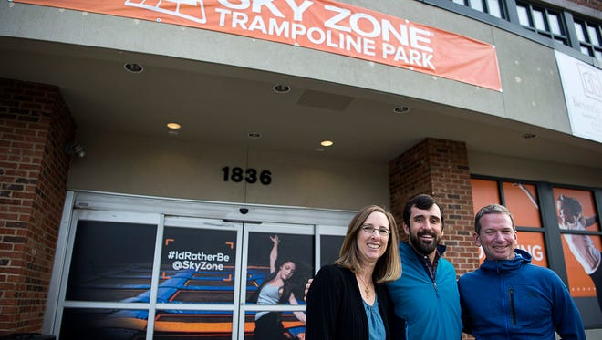 Sales and community manager Gavin Young, left, managing partner Charles Conner, middle, and operations manager Curt Roth, right, stand in front of Sky Zone Trampoline Park, a new trampoline park off Hendersonville Road expected to open the start of February 2017.
