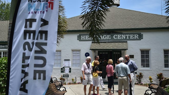 People mingle outside the Heritage Center in downtown Vero Beach June 10, 2016, during the Vero Beach Wine and Film Festival. Lighting, or lack of it, is a concern for downtown Vero Beach business owners who want to attract more customers at night.