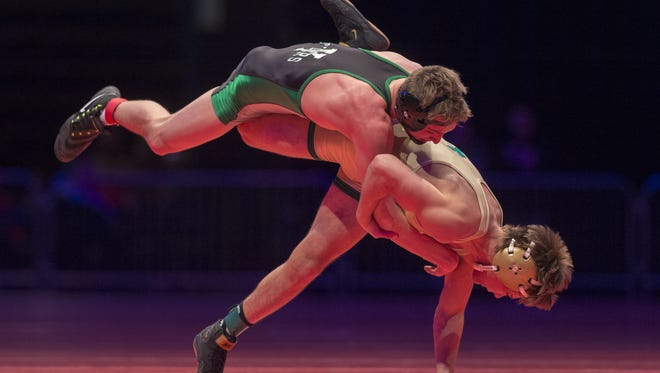 Yorktown High School's Christian Hunt, left, wrestles with Indianapolis Cathedral High School's Jordan Slivka in the 145 lb. class during the championship round of the 2018 IHSAA Wrestling State Tournament, Saturday, February 18, 2018, at Bankers Life Fieldhouse in Indianapolis.
