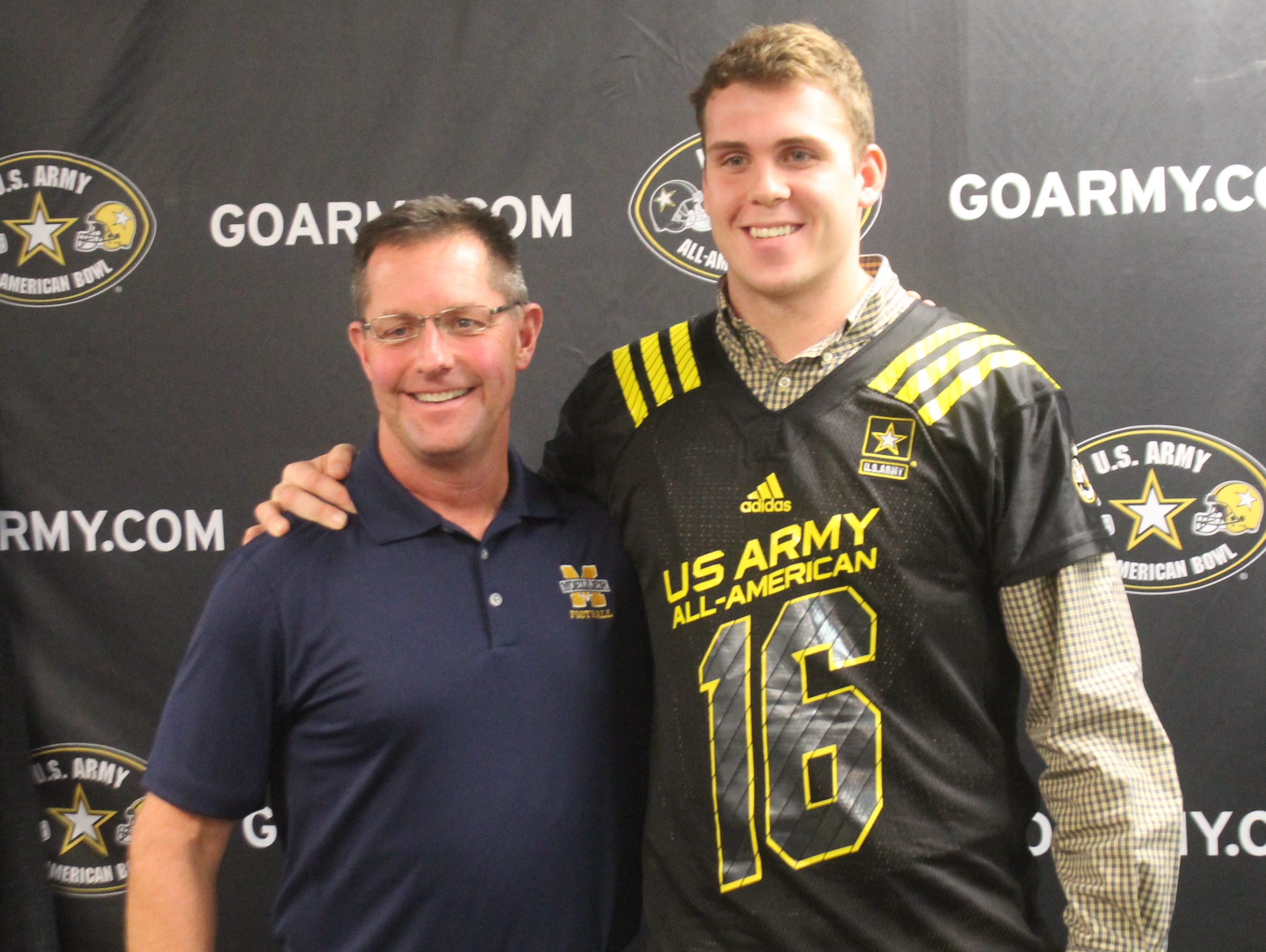 Moeller tight end Jake Hausmann will participate in the U.S. Army All-American Bowl in January. With Hausmann is Moeller head coach John Rodenberg