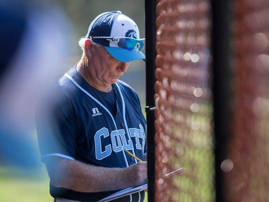 CBA Coach Marty Kenney looks over his notes as he coaches his team to their 800th victory under his coaching. CBA baseball defeats Wall in seventh inning heroics during Strikeout Autism Baseball Challenge at Central Regional High School in Berkeley on April 14, 2018.