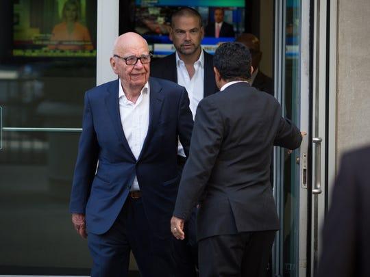 Rupert Murdoch leaves the News Corporation building