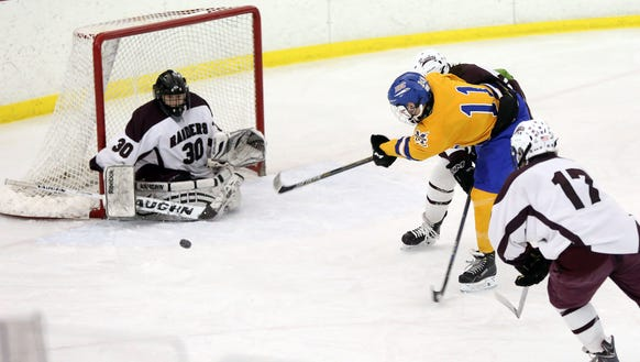 Scarsdale goaltender Sam Seltzer stops a Mahopac shot