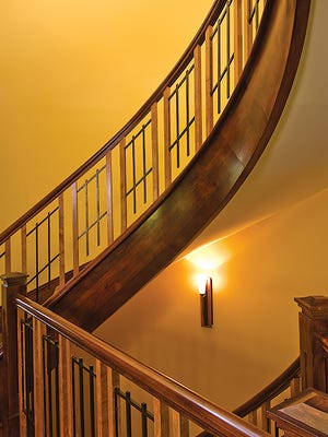 The staircases, done in cherry wood and metal, have a Craftsman feel.