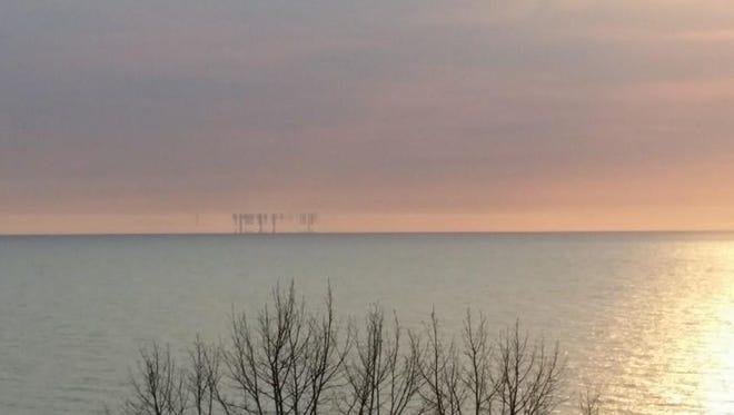 A mirage of Chicago skyline upside down startled campers along Lake Michigan at Warren Dunes State Park in Bridgman on April 18, 2015.