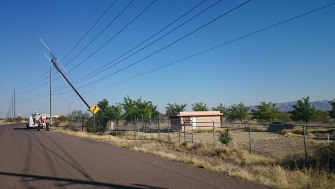 Deputies with the Maricopa County Sheriff's Office are investigating what caused a wooden cell tower pole to fall onto power lines in Wittmann on Saturday, June 20, 2015. The incident caused a power outage affecting over 1,700 residents.