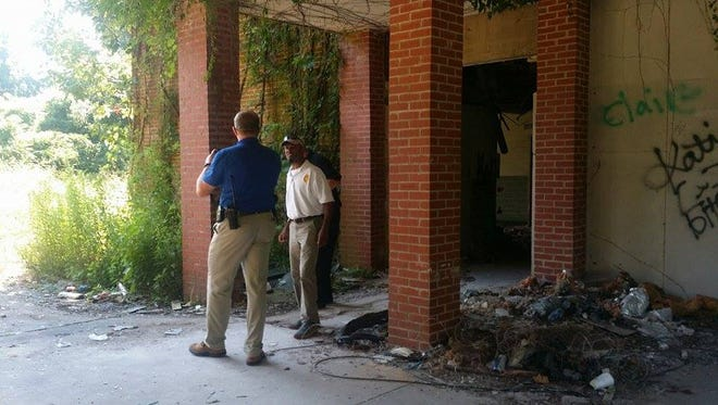 Police on the scene of where the body of a missing woman was found at Kuhn Memorial State Hospital in Vicksburg.
