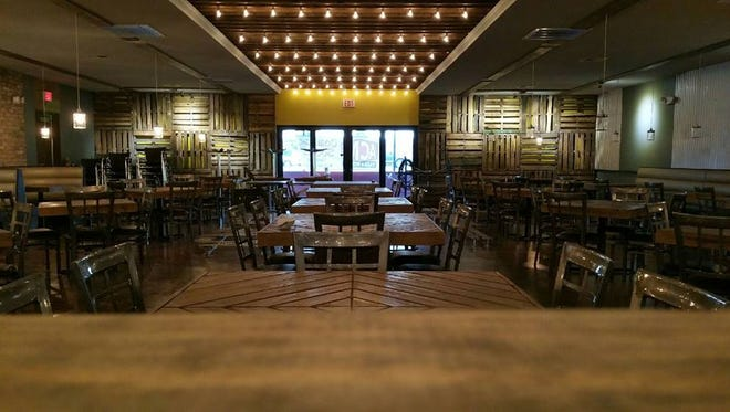 The interior of Acme Taco & Burger is pictured just before the opening.