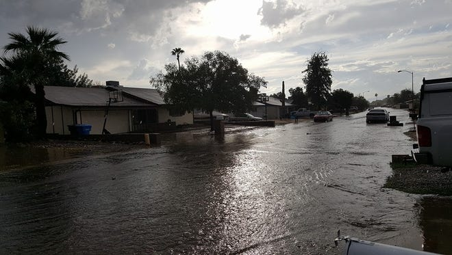 A flooded street near 43rd Avenue and Cactus from storms in the Phoenix area on Sunday, Oct. 18, 2015.