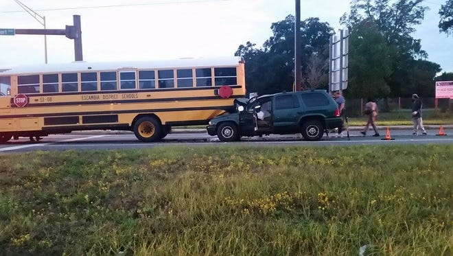 A school bus driver received minor injuries after her bus was struck by another vehicle Wednesday morning.