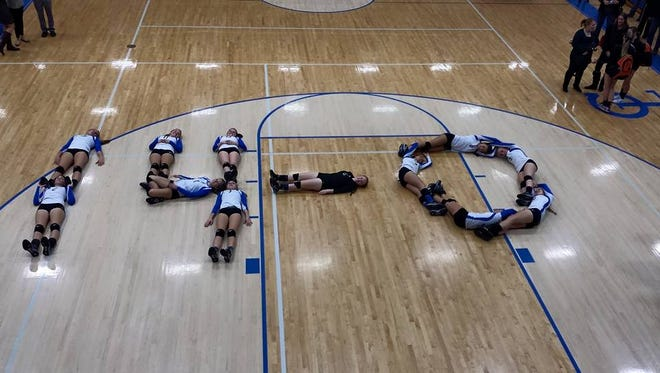 The Pioneers show off their perfect Blue Water Area Conference volleyball record (14-0)