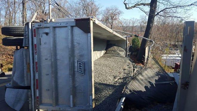 Gravel truck overturned, closing Snake Hill Road on Monday morning.