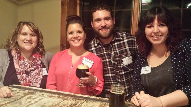 100 or more people gathered at Door County Brewing Co in Baileys Harbor for the first Young Professionals Network event. The new group has formed to encourage the county's business people between ages of 20 and 40 to interact and network. Pictured: Amy Sullivan, Molly Peterson, Robert Peterson and Beth Levendusky.